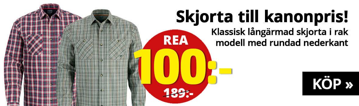 Klassisk långärmad skjorta i rak modell med rundad nederkant